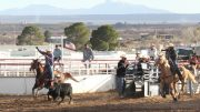 Eric Burk Photo: Gila Valley Central: Wyatt Kent and Daylan Barton chase a calf to win the high school team roping event.