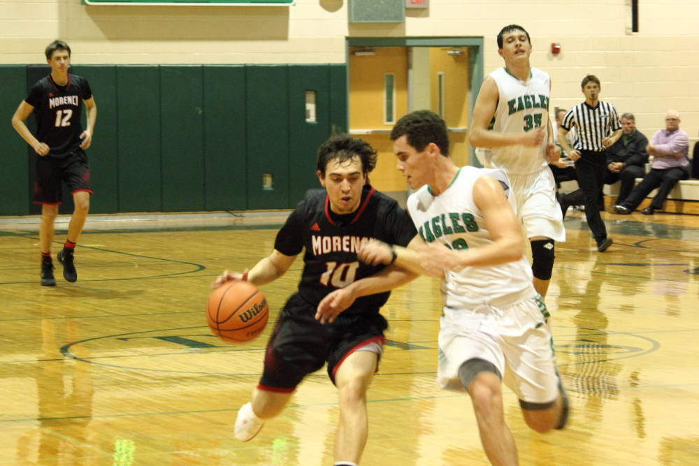 Eric Burk Photo/Gila Valley Central: Morenci's David Corona tries to dribble past Thatcher point guard Logan McMaster.