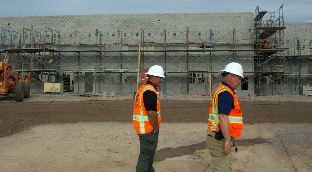 Jon Johnson Photo/Gila Valley Central: Jail Commander Tim Graver, right, and Lt. Tavini Sulusi tour the new adult detention facility and sheriff's office.