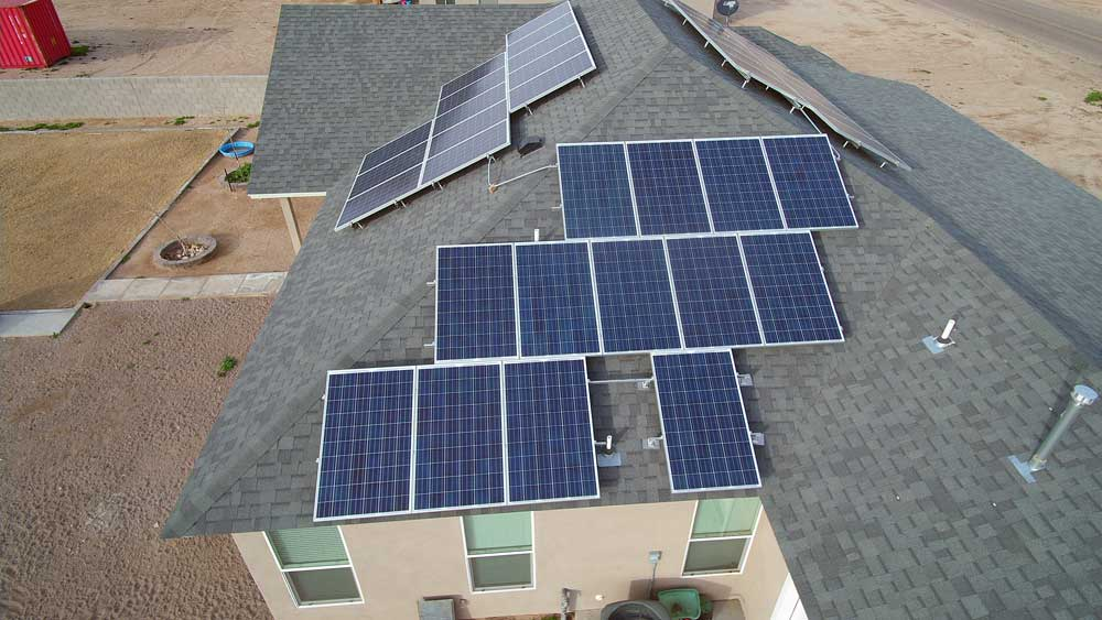 Jon Johnson Photo/Gila Valley Central: This Pima residence has solar panels on three sides of its roof to capture as much sun as possible.